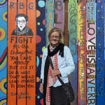 YSA Director Sally Hindman with favorite images on the fence panels