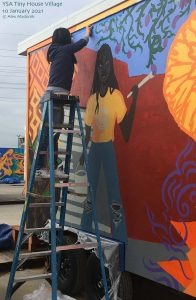 Painting a mural of a mural painter